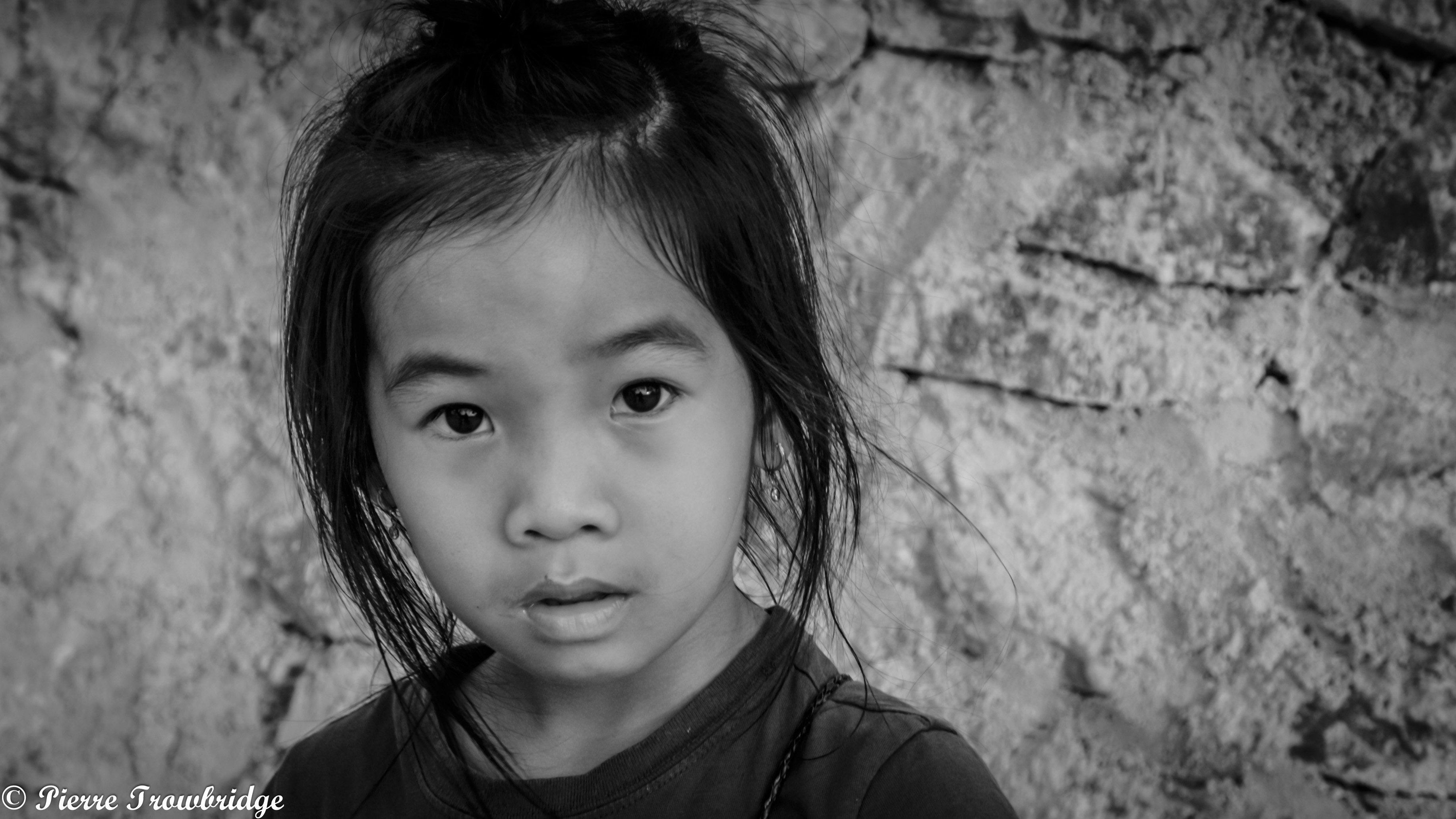A young cutie isn't quite sure what to make of me in A Luoi. Ho Chi Minh Trail, Vietnam